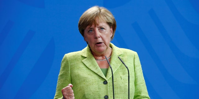 German Chancellor Angela Merkel addresses a news conference at the Chancellery in Berlin last August.