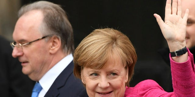 German Chancellor Angela Merkel attends celebrations for the 500th anniversary of the Reformation in front of the grave of Martin Luther at the Castle Church in Wittenberg, Germany, Tuesday, Oct. 31, 2017.