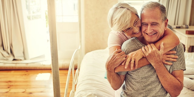 Cropped shot of a senior couple embracing in their bedroom