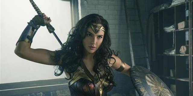 Wonder Woman works up an appetite for a thinkThin-brand protein nut bar.