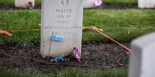 This Monday, Aug. 7, 2017 photo shows the headstone of Little Plume (aka Hayes Vanderbilt Friday), at Carlisle Barracks Cemetery in Carlisle, Pa.