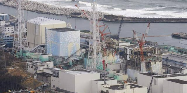 In this March 11, 2012, file photo, three melted reactors, from left, Unit 1, Unit 2 and Unit 3, are seen at Fukushima Dai-ichi nuclear power plant in Okuma, Fukushima prefecture, Japan.