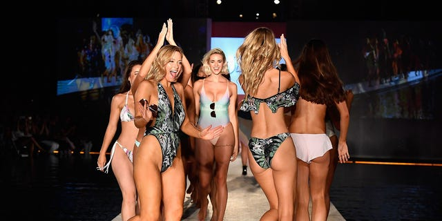 MIAMI BEACH, FL - JULY 22:  Models walk the runway during SWIMMIAMI Sports Illustrated Swimsuit 2018 Collection at WET Deck at W South Beach on July 22, 2017 in Miami Beach, Florida.  (Photo by Frazer Harrison/Getty Images for SWIMMIAMI)
