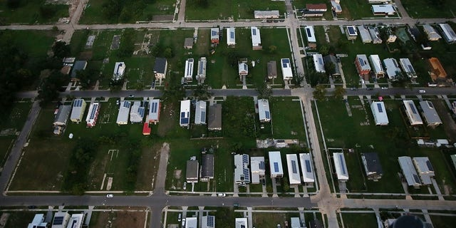 A 2015 photo shows new homes, many with solar panels constructed by the Make it Right Foundation, mixed with old homes and vacant lots in the Lower Ninth Ward in New Orleans, Louisiana.