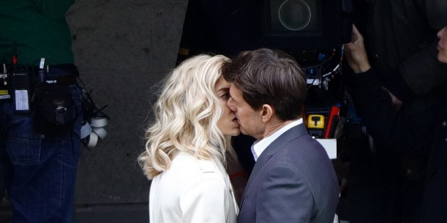 """Tom Cruise seen kissing Vanessa Kirby during a scene for """"Mission Impossible 6"""" in Paris, France, on May 2, 2017."""