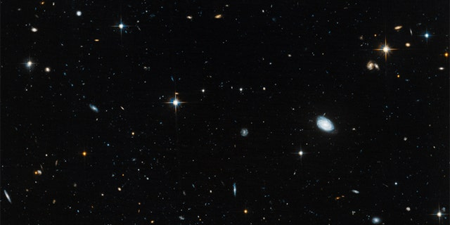 Astronomers used the NASA/ESA Hubble Space Telescope to unmask the dim, star-starved dwarf galaxy Leo IV.