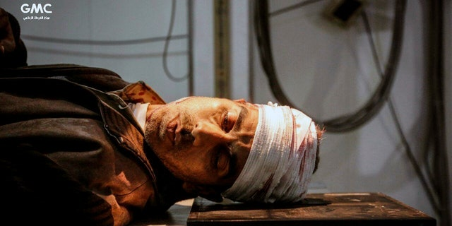 An injured man waits for treatment at a hospital in Ghouta, a suburb of Damascus.