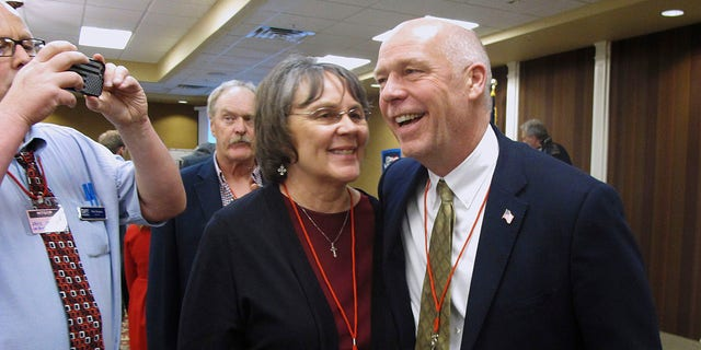 Greg Gianforte right receives congratulations from a supporter in Helena Mont. Montana voters are heading to the polls Thursday