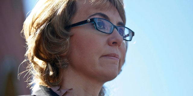 Former congresswoman Gabrielle Giffords addresses a news conference for victims of the January 8, 2011 Tucson shooting, at the Safeway grocery store parking lot where Giffords was shot during the incident in Tucson March 6, 2013. The news conference was held to urge action on common sense solutions to reduce gun violence, including universal background checks, which will be taken up by the Senate Judiciary Committee later this week. REUTERS/Samantha Sais (UNITED STATES - Tags: CRIME LAW POLITICS PROFILE) - RTR3ENSR