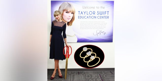 NASHVILLE, TN - OCTOBER 12:  Singer Taylor Swift officially opens the Taylor Swift Education Center at the Country Music Hall of Fame and Museum on October 12, 2013 in Nashville, Tennessee. Seven-time GRAMMY winner Swift's $4 million gift to endow the center is the largest individual artist gift in the Hall of Fame's history. (Photo by Royce DeGrie/TAS/Getty Images for TAS)