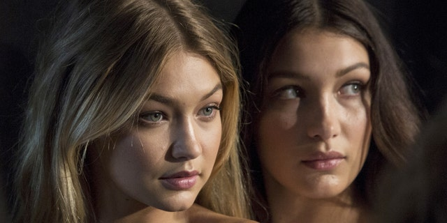 Gigi and Bella Hadid's nude magazine shoot is being slammed by fans on social media. Here, the sisters pose for photos backstage before the Tommy Hilfiger Spring/Summer 2016 collection presentation during New York Fashion Week in New York, September 14, 2015