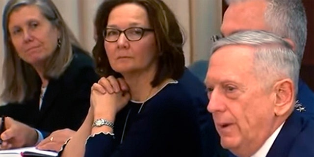 Nominee to head the CIA, Gina Haspel, center, sits alongside Secretary of Defense Jim Mattis.