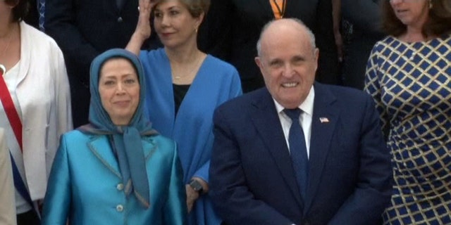 Rudy Giuliani poses for a photo with Maryam Rajavi, the leader of the National Council of Resistance of Iran, at a rally in Villepinte, France Saturday.