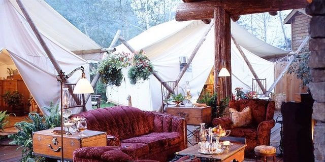 The tent lounge area at Clayouquot Resort in Vancouver Island, Canada has comfy couches and amenities you'd find at home.