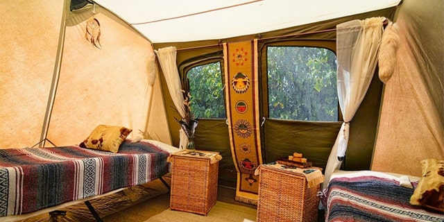 Guests pay roughly $750 a night to bed down in a spacious canvas tent, complete with cushy cots, blankets, rugs and even cowhide pillows.