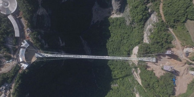 Officials at Zhangjiajie say that bridge had 10 times the amount of its load capacity of only 8,000 people per day.