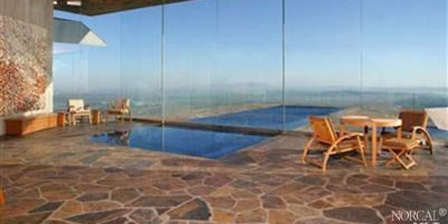 A pool stretched from the interior of the home into the open air.