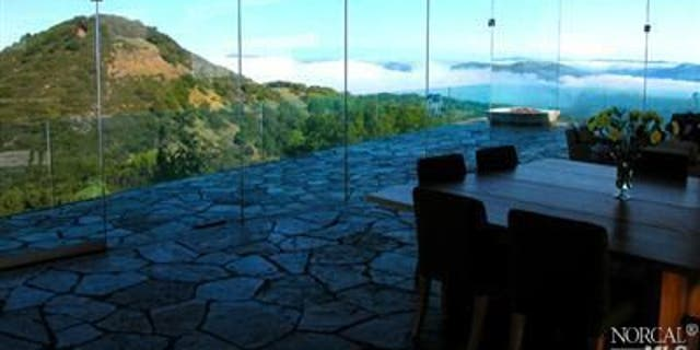 Floor-to-ceiling windows surrounded the 'Glass House' of Solano County.