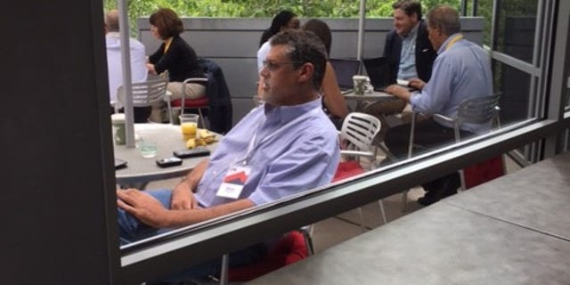 Simpson, seen here in a picture taken at a security forum in Aspen, Colo., in July, was a Wall Street Journal reporter before co-founding Fusion GPS  (Fox News)