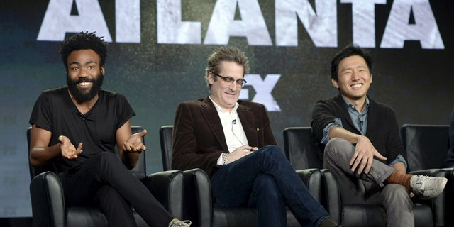 """Donald Glover attends a panel for """"Atlanta"""" with executive producer Paul Simms and director Hiro Murai."""