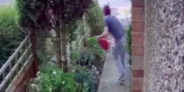 CCTV footage shows the man sneaking along a path at the side of a house before he reappears moments later carrying the garden ornament.