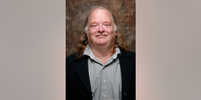 """Jonathan Gold, from the movie """" CITY OF GOLD"""" poses at the L.A. Times photo & video studio at the Sundance Film Festival, in Park City, Utah in 2015."""