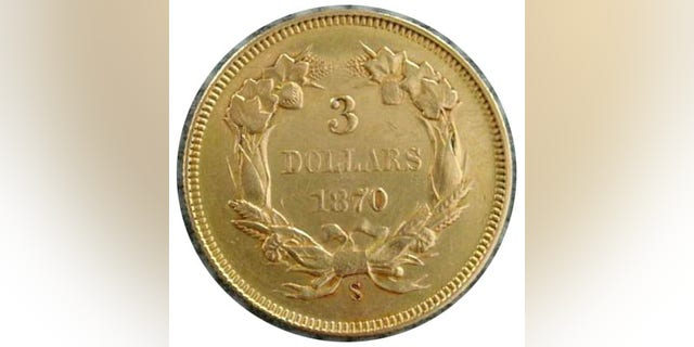 The coin, seen here, is believed to be a 1870-S $3 piece from the San Francisco Mint that was found embedded into a souvenir book, according to Steve White, owner of the Four Seasons Auction Gallery. (Courtesy: Four Seasons Auction Gallery)