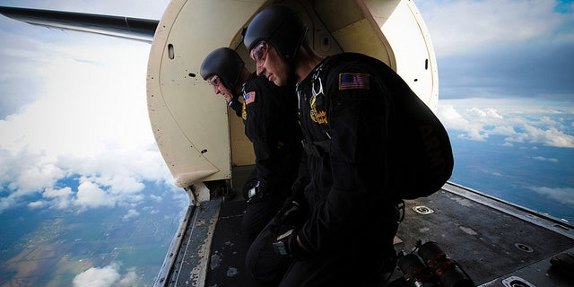 Golden knight parachutists ready to jump