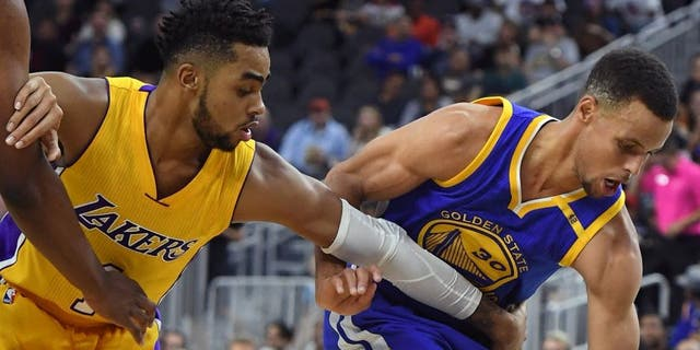 LAS VEGAS, NV - OCTOBER 15: Stephen Curry #30 of the Golden State Warriors steals the ball from D'Angelo Russell #1 of the Los Angeles Lakers during their preseason game at T-Mobile Arena on October 15, 2016 in Las Vegas, Nevada. Golden State won 112-107. NOTE TO USER: User expressly acknowledges and agrees that, by downloading and or using this photograph, User is consenting to the terms and conditions of the Getty Images License Agreement. (Photo by Ethan Miller/Getty Images)