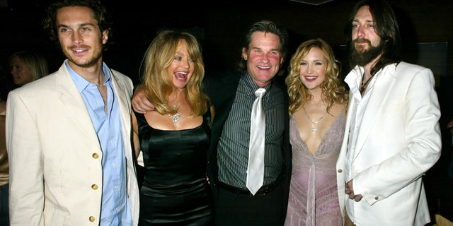 Oliver Hudson, left, with mom Goldie Hawn, Kurt Russell and sister Kate Hudson.