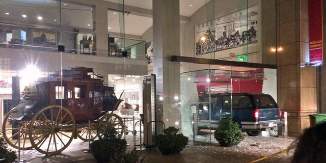Jan. 27: A vehicle is seen smashed into the window of the Wells Fargo History Museum in downtown San Francisco.