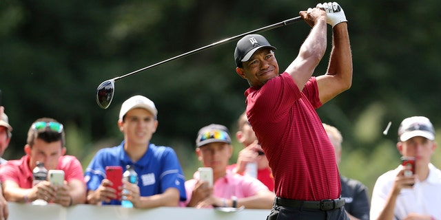 Tiger Woods watches his shot on the fifth hole during the final round of the Northern Trust golf tournament.