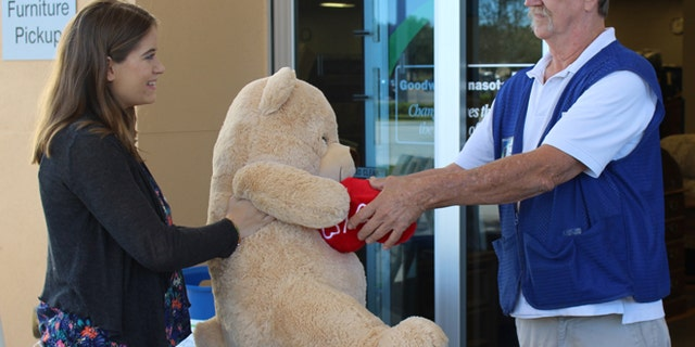 Amanda Emory drops off a giant Valentine's Day teddy bear from her ex-boyfriend to Goodwill Manasota's Tom Lohr. (Goodwill Manasota)