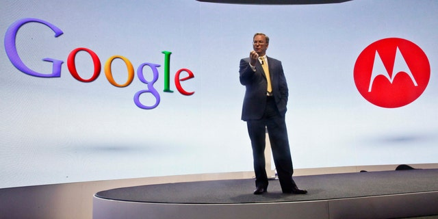 FILE - In this Wednesday, Sept. 5, 2012, file photo, Eric Schmidt, Google's chairman, speaks during a press conference in New York, where Motorola introduced three new smartphones, the first since it became  a a part of Google.  Google said Wednesday, Jan. 29, 2014, it is selling Motorola's smartphone business to Lenovo for $2.9 billion, a price that makes Google's biggest acquisition look like its most expensive mistake.(AP Photo/Bebeto Matthews, File)