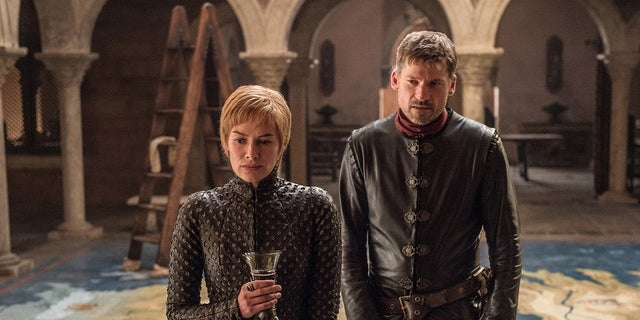 "This image released by HBO shows Lena Headey, left, and Nikolaj Coster-Waldau in ""Game of Thrones,"" which premiered its seventh season on Sunday, July 16. (Helen Sloan/HBO via AP)"