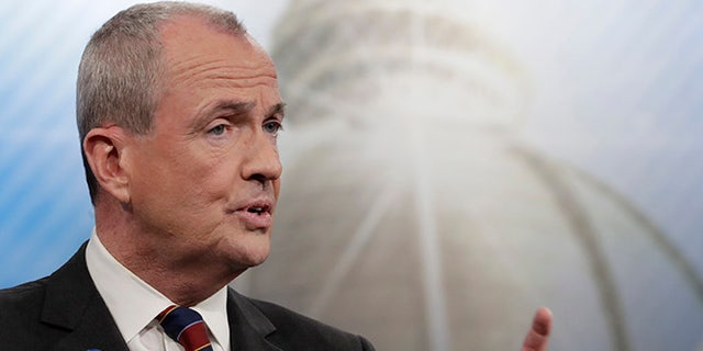 FILE- In this May 11, 2017, file photo, Phil Murphy participates in a Democratic gubernatorial primary debate in Newark, N.J. New Jersey voters are heading to the polls to pick their candidates to succeed Republican Gov. Chris Christie on Tuesday, June 6. (AP Photo/Julio Cortez, File)