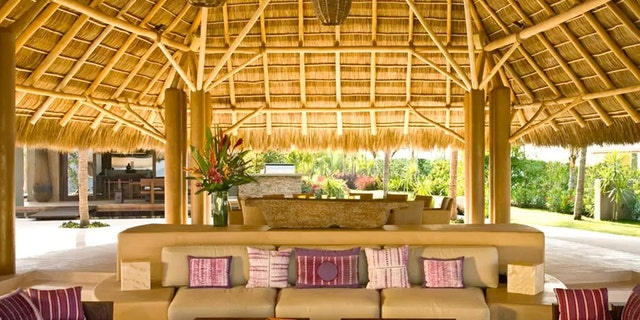 A palm thatched roof seating area provides oceanfront seating and a place to escape the heat and enjoy a cocktail.