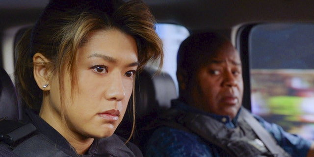 """Pictured left to right: Grace Park as Kono Kalakaua and Chi McBride as Lou Grover in CBS' """"Hawaii 5-0."""""""
