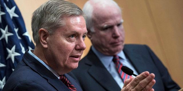 Jan. 3, 2014: Sen. Lindsey Graham, R-S.C., left, speaks near Sen. John McCain, R-Ariz., during a news conference at the David Citadel hotel in Jerusalem.