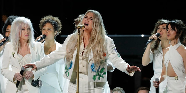 Kesha led a group of women in a tribute to victims of sexual assault at the 2018 Grammys.