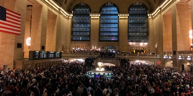 Commuters are stranded in Grand Central Terminal during the evening commute on Tuesday in New York. The Metro-North commuter railroad said Tuesday evening that downed trees across the tracks had caused it to suspend service on its Harlem, Hudson and New Haven lines.