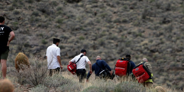Emergency personnel arrive at the scene of a deadly helicopter crash in Arizona.