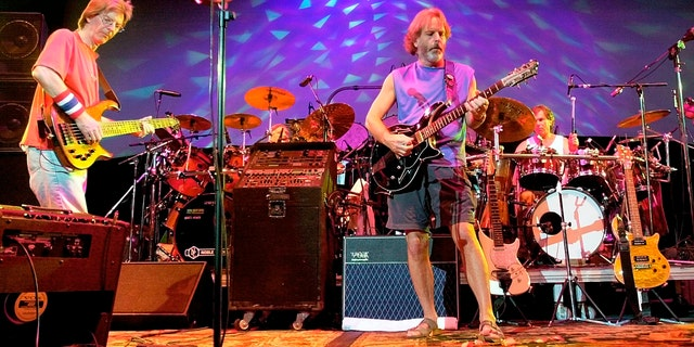 The Grateful Dead, from left, Phil Lesh, Bill Kreutzmann, Bob Weir and Mickey Hart perform during a reunion concert in East Troy, Wis. on Aug. 3, 2002.