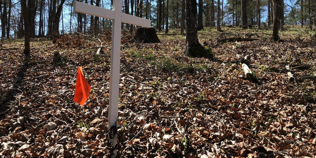 White crosses mark where archaeologists believe soldiers' graves lie.