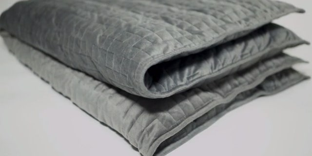 """The Brooklyn-based makers say the blanket, which comes in three weights and should weigh about 10 percent of body weight, uses """"deep pressure touch stimulation"""" to boost brain hormones that """"improve your mood."""""""