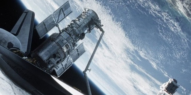 "Director Alfonso Cuarón's visually stunning film ""Gravity,"" in theaters today, is already being heralded as one of the year's best movies. Sandra Bullock and George Clooney star as astronauts whose mission goes spectacularly wrong when a cloud of orbital debris shreds their shuttle, cuts off communication and leaves them stranded in space."