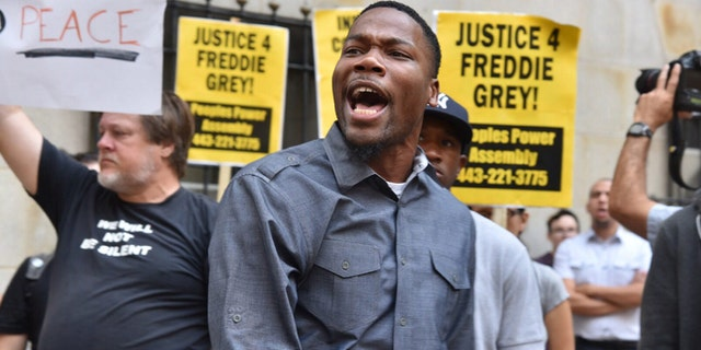 Sept. 2: Protesters gather outside Baltimore Circuit Court, as the first court hearing was set to begin in the case of six police officers criminally charged in the death of Freddie Gray.