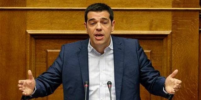 July 31, 2015: Greek Prime Minister Alexis Tsipras answers opposition questions in parliament in Athens.