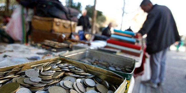 Dec. 9, 2011: Old drachma coins are displayed for sale at an outdoor market in Athens.
