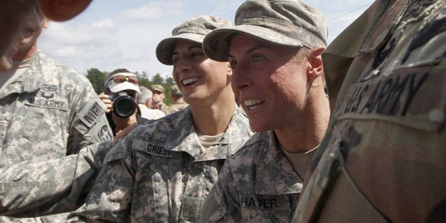 FILE 2015: From the left, Capt. Kristen Griest and 1st Lt. Shaye Haver are congratulated at Ranger school graduation at Fort Benning.